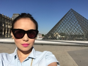 Bright pink lips to match the bight weather outside the Louvre Museum in Paris.